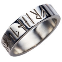 Celtic wedding ring with runic engraving around the outside of the ring